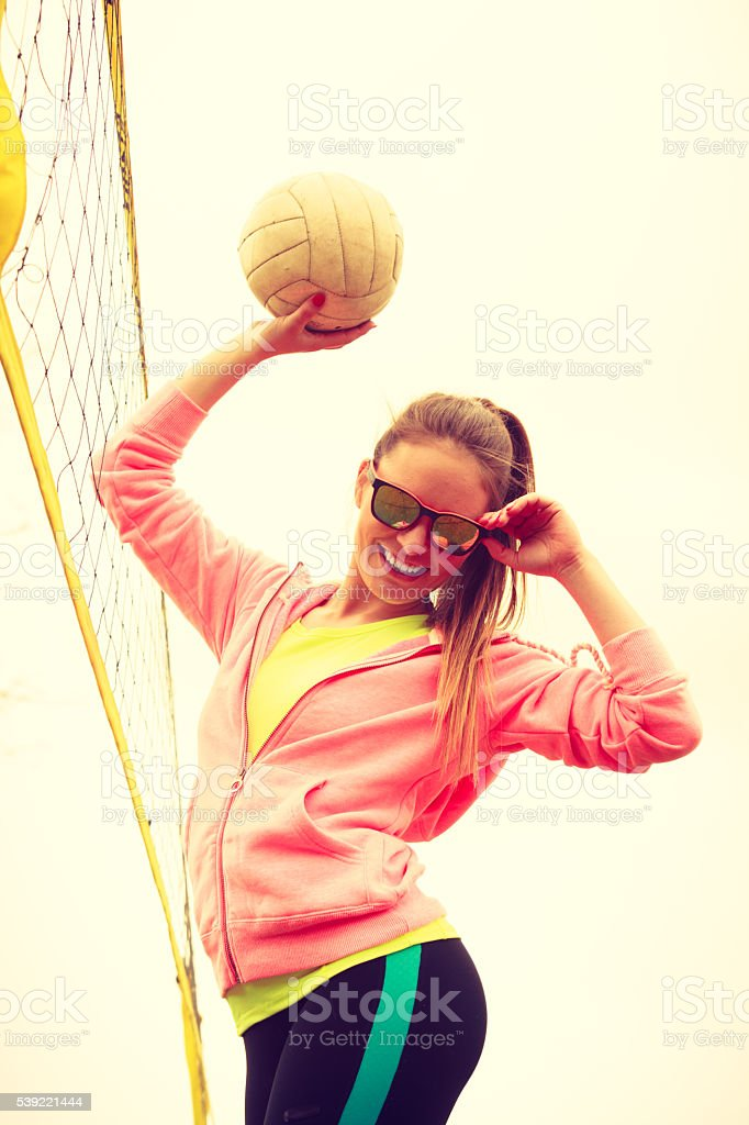 Woman volleyball player outdoor on court stock photo