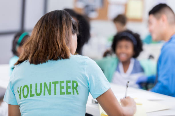 Woman volunteers at a free medical clinic stock photo