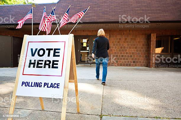 Woman voter entering voting polling place for usa government election picture id478598956?b=1&k=6&m=478598956&s=612x612&h=7nrl8snzaf8nkbaijqiotst8y 4arrfk7cheigze7yq=