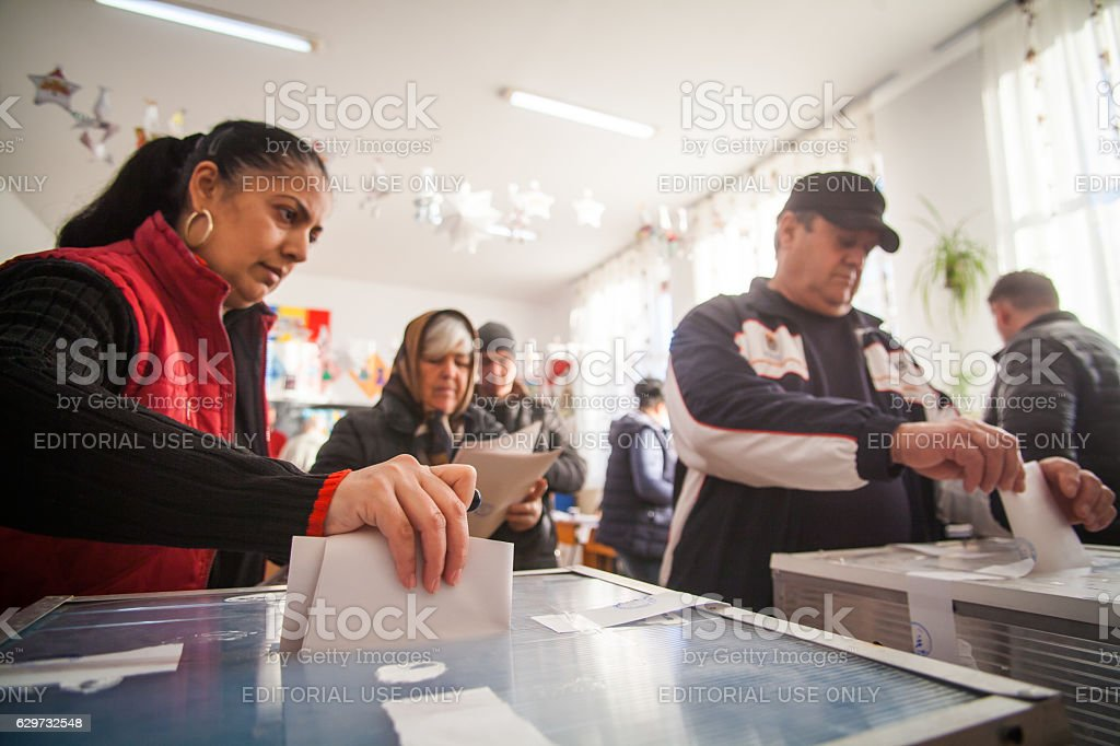 Woman voting at polling station stock photo