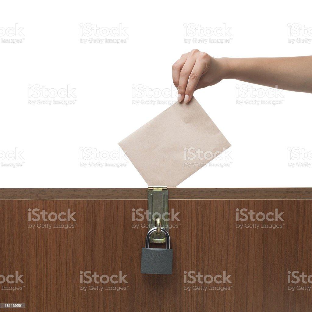 Woman voting on ballot box royalty-free stock photo