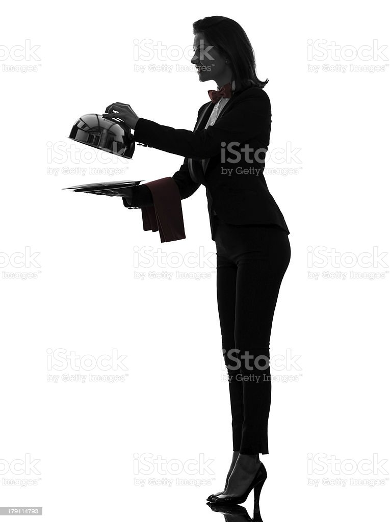 woman waiter butler opening catering dome silhouette royalty-free stock photo