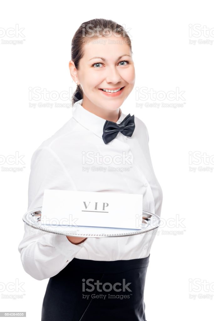 Woman waiter with VIP sign on a tray isolated in the studio stock photo