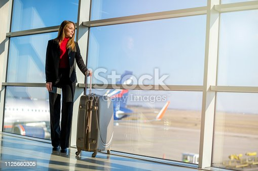istock Woman waiting at the airport 1125660305