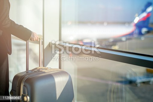 istock Woman waiting at the airport 1125669597
