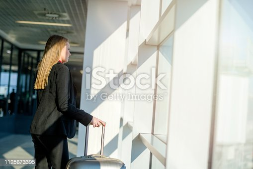 istock Woman waiting at the airport 1125673395