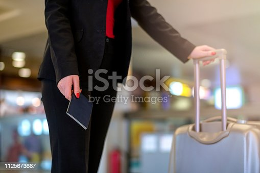 512522378 istock photo Woman waiting at the airport 1125673667