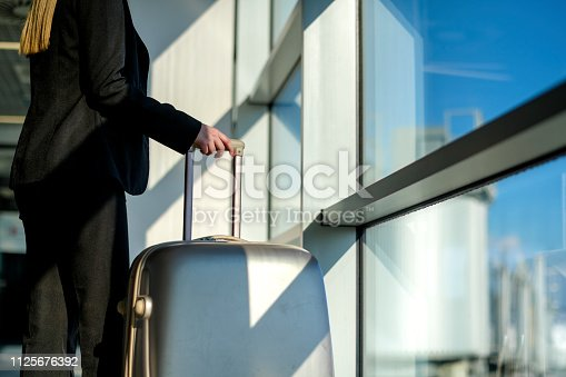 512522378 istock photo Woman waiting at the airport 1125676392
