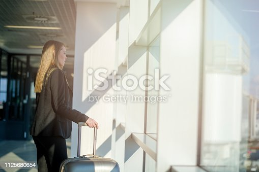 512522378 istock photo Woman waiting at the airport 1125680654