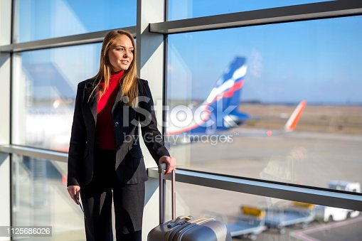 istock Woman waiting at the airport 1125686026
