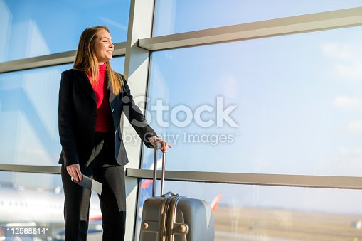 istock Woman waiting at the airport 1125686141