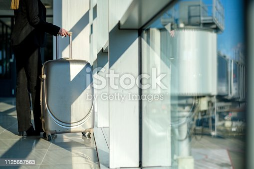 istock Woman waiting at the airport 1125687563