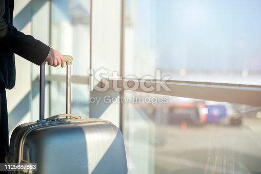 istock Woman waiting at the airport 1125687883
