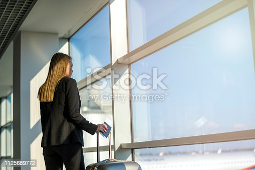 512522378 istock photo Woman waiting at the airport 1125689772