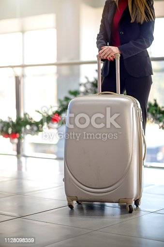 istock Woman waiting at the airport 1128098359