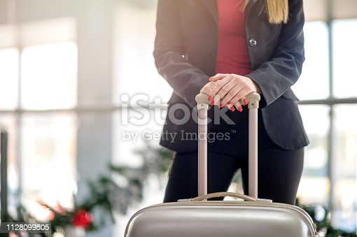 512522378 istock photo Woman waiting at the airport 1128099805