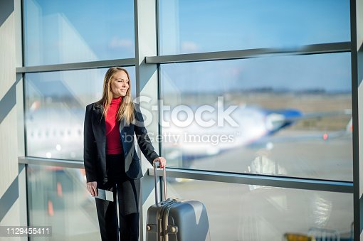 istock Woman waiting at the airport 1129455411