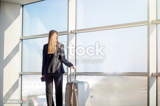 istock Woman waiting at the airport 1129456419