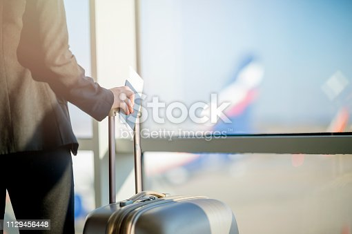 istock Woman waiting at the airport 1129456448