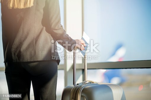 istock Woman waiting at the airport 1129456924