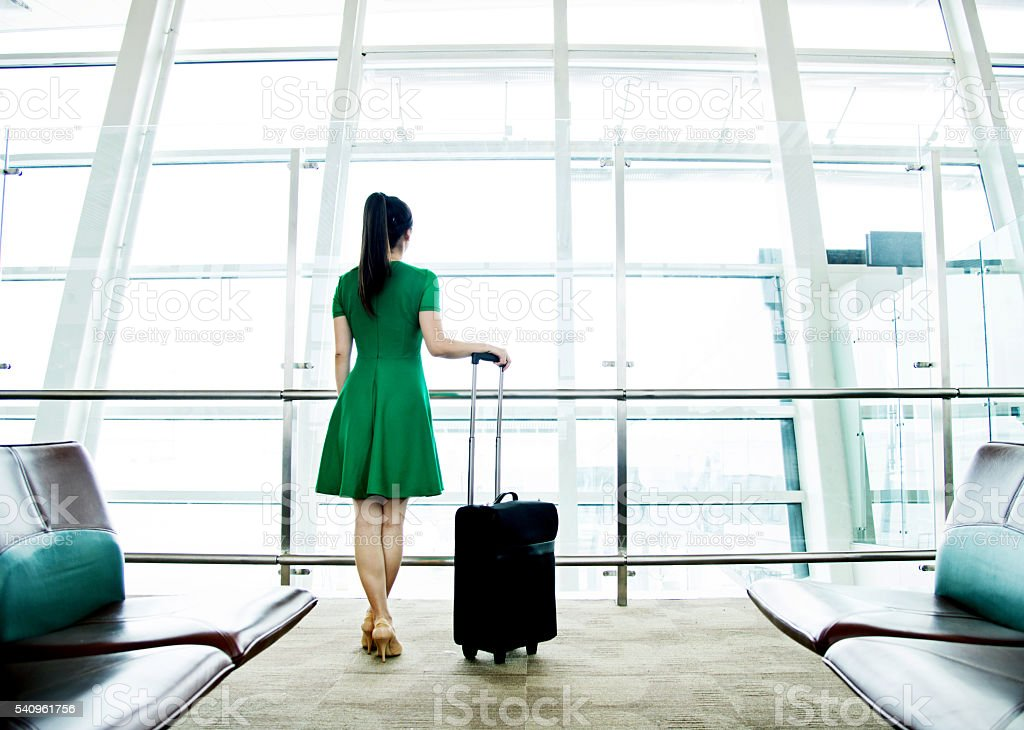 Woman waiting at the airport stock photo