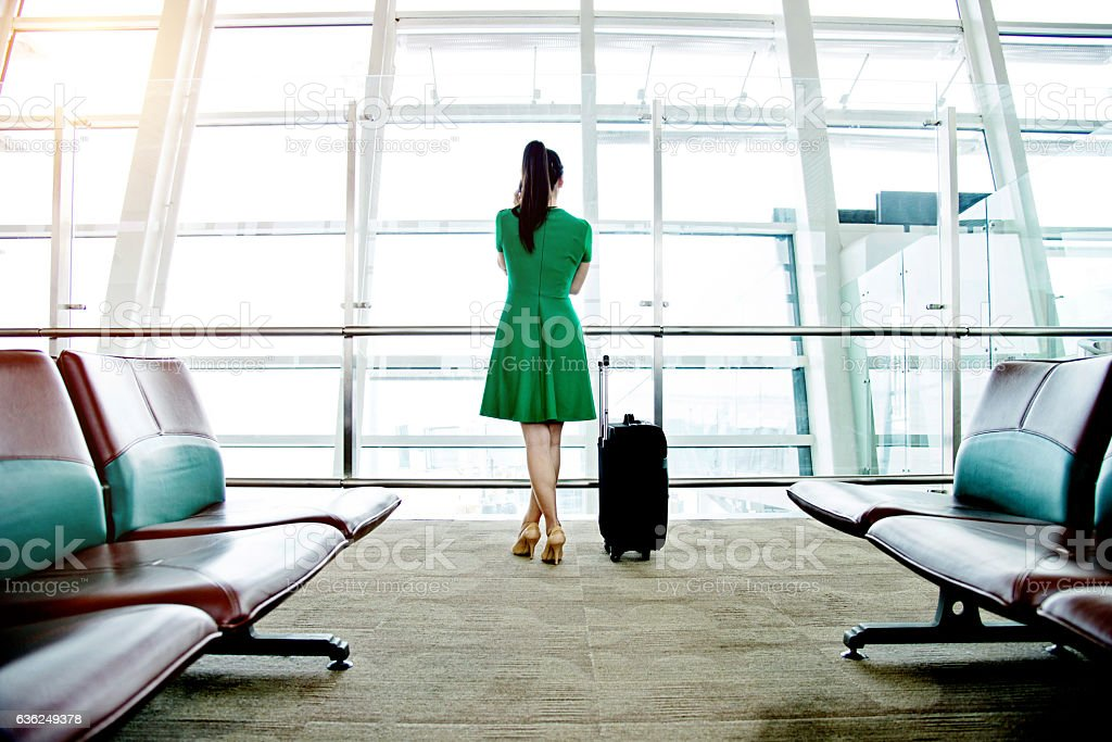 Woman waiting at the airport stock photo