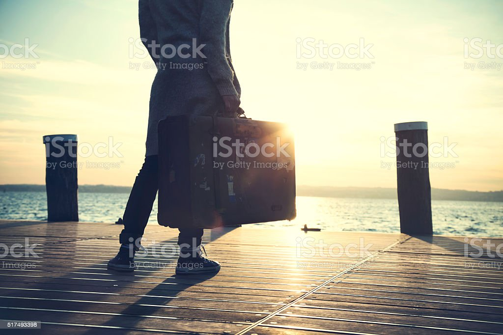 woman waiting for a ship to leaving on a trip stock photo