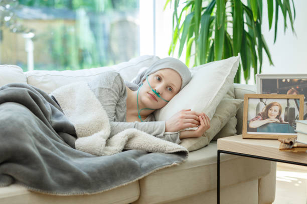 Woman waiting for cancer remission Woman waiting for cancer remission to come back to normal life oxygen tube stock pictures, royalty-free photos & images