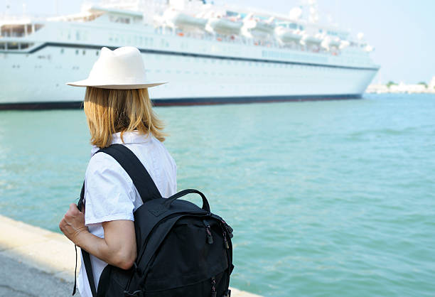 Woman Waiting for Cruise Ship Woman ready for leaving inside harbor mooring stock pictures, royalty-free photos & images