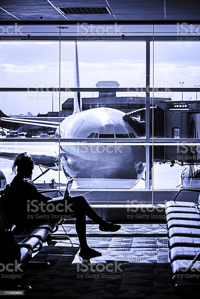 Woman waiting for flight at airport lounge royalty-free stock photo