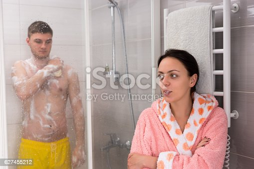 536952169 istock photo Woman waiting for her boyfriend while he rubbing himself 627455212