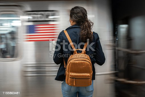 Woman waiting for subway