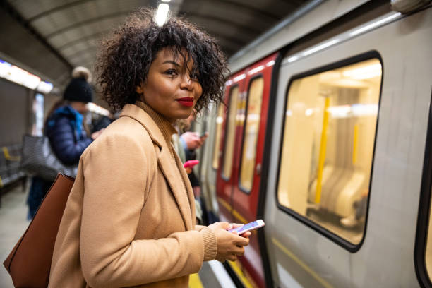 Woman waiting for the subway train stock photo