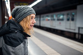 Young beautiful  woman waiting for train at subway station in Barcelona Spain