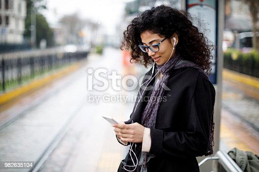 Woman waiting for train at the station