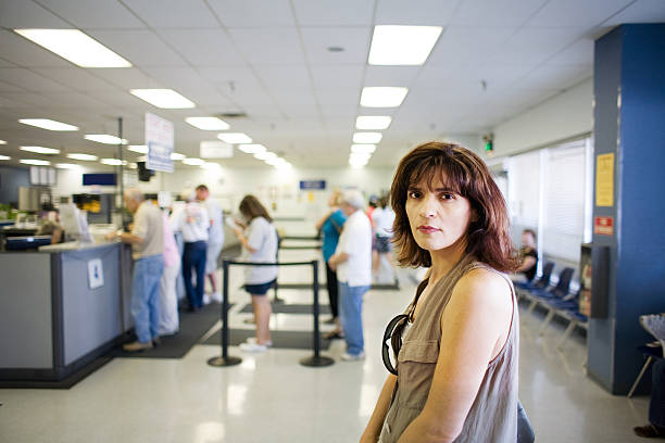 woman waiting in line - unemployment stock pictures, royalty-free photos & images