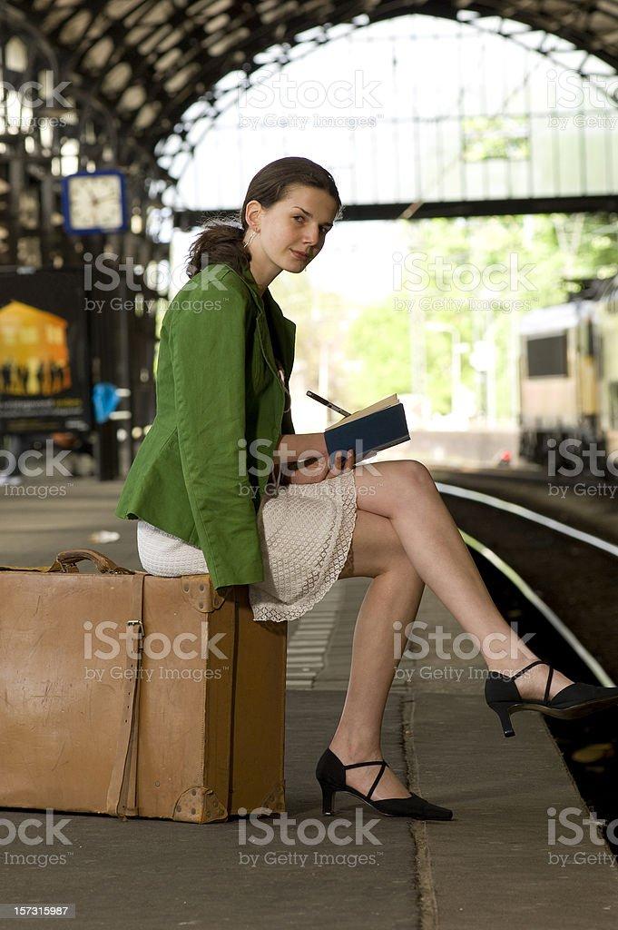 woman waiting on railroad station platform royalty-free stock photo