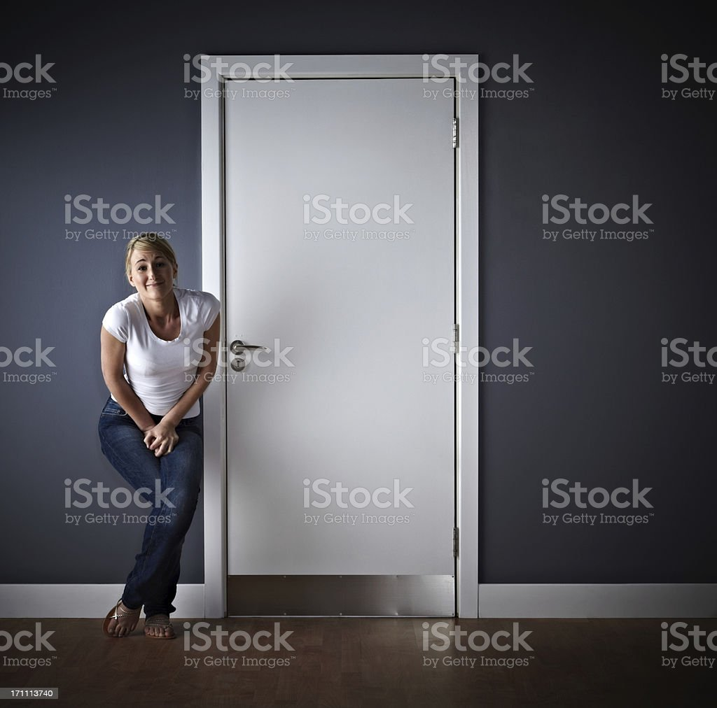 Woman waiting outside ladies toilet stock photo