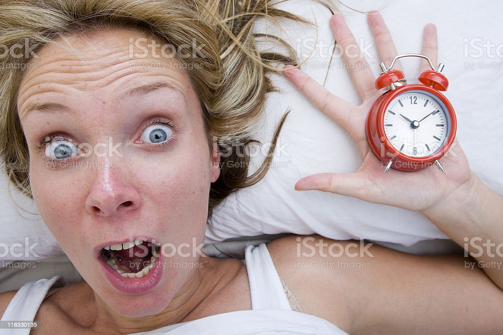 Woman waking up Late royalty-free stock photo