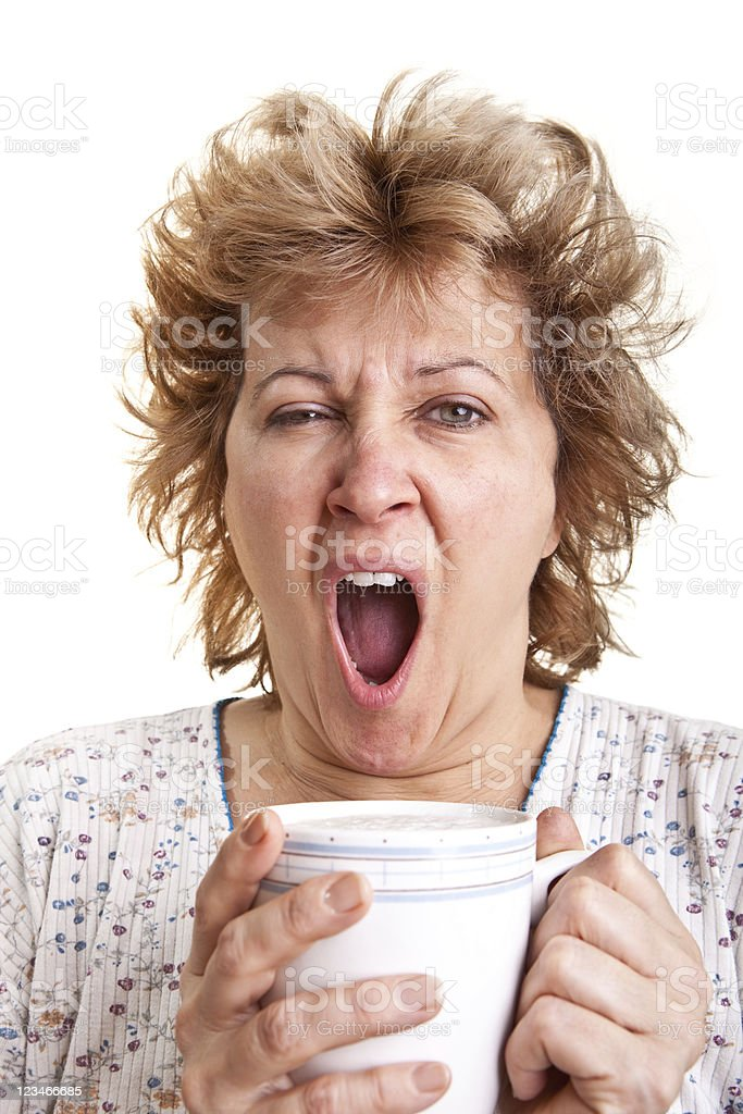 Woman waking up with a coffee stock photo