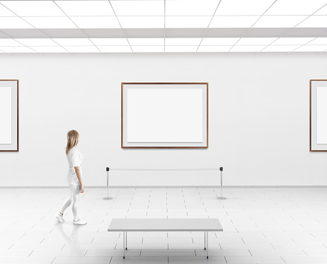 Woman walk in museum hall blank wall with frames