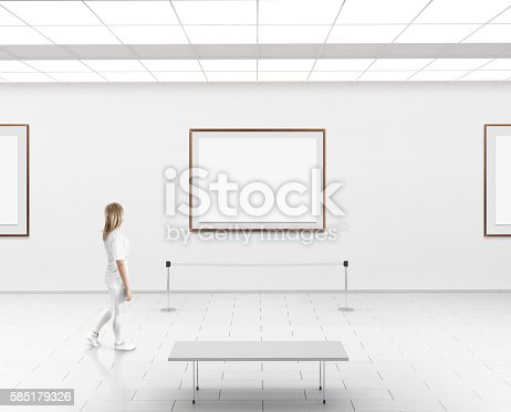 istock Woman walk in museum hall blank wall with frames 585179326