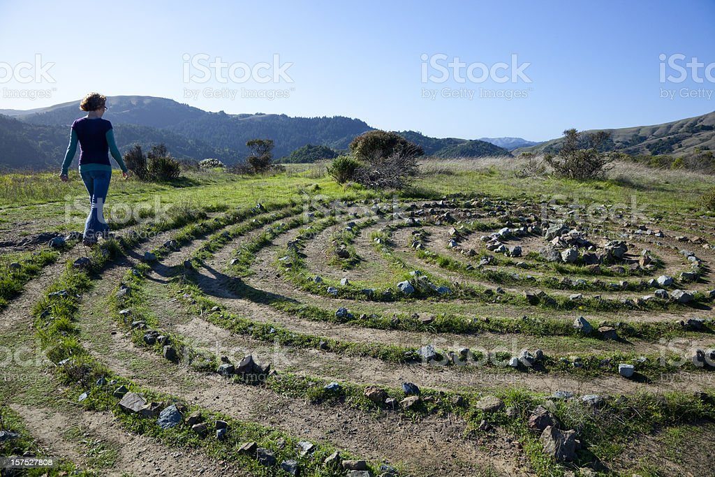 woman walking a labyrinth stock photo