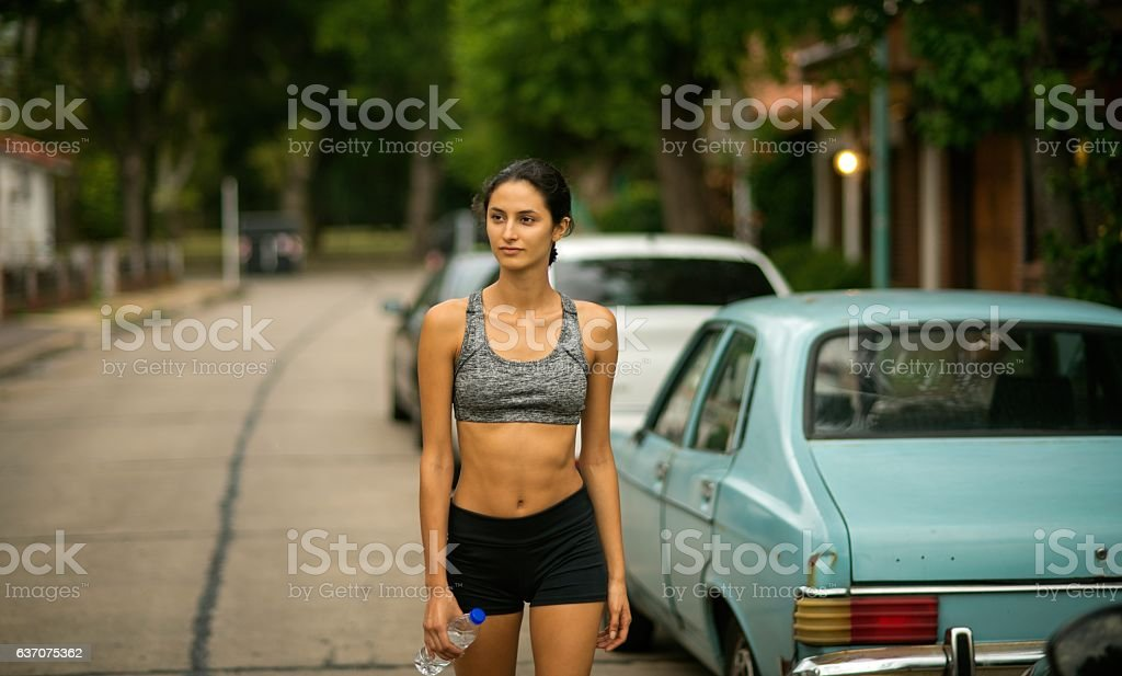 Woman walking after exercising stock photo