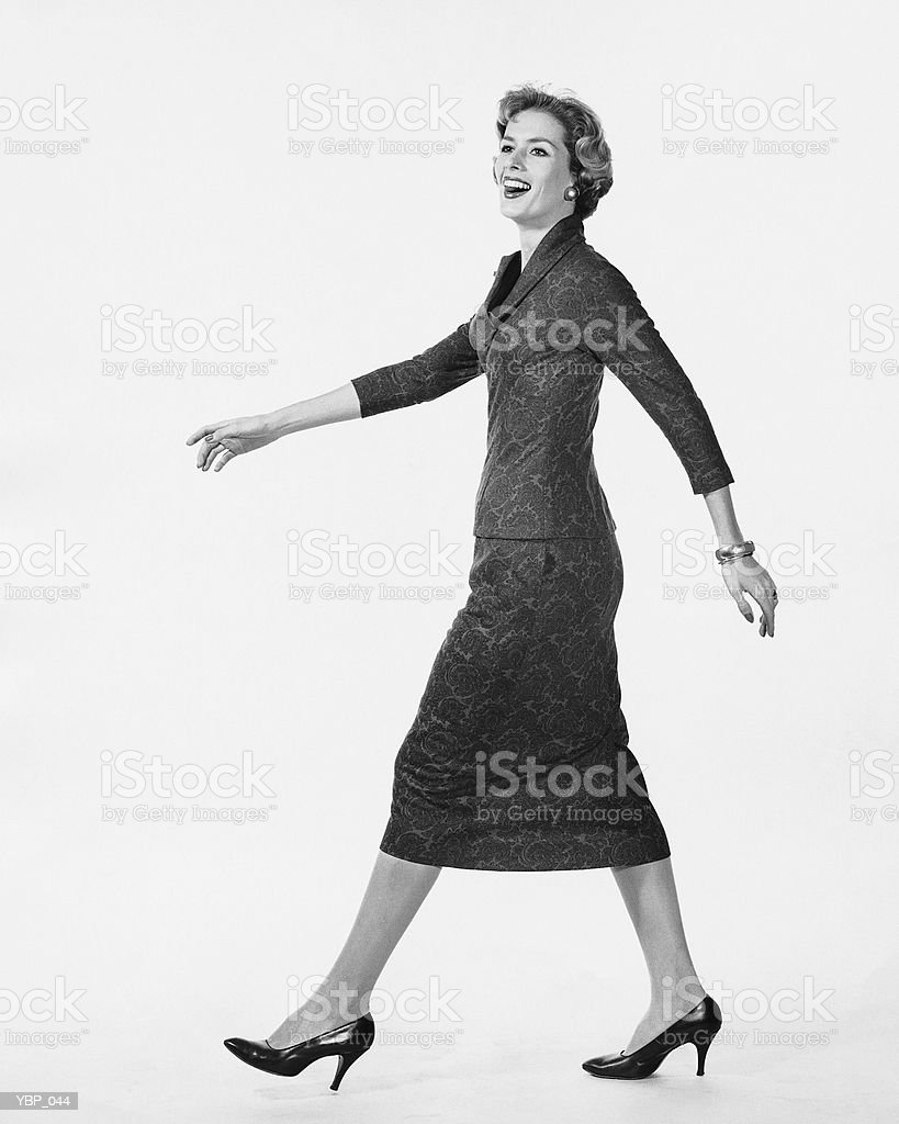 Woman walking and smiling royalty-free stock photo