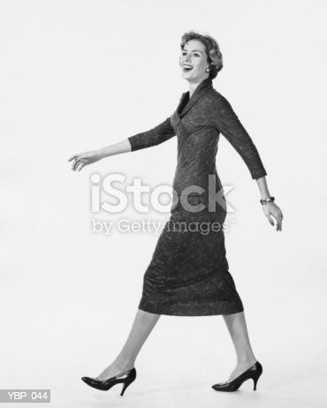 Woman Walking And Smiling Stock Photo & More Pictures of 1950-1959