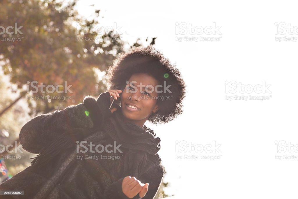 Woman walking and talking on the phone in downtown royalty-free stock photo