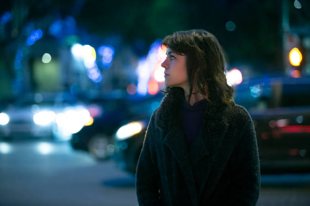 Woman Walking At Night in the City stock photo