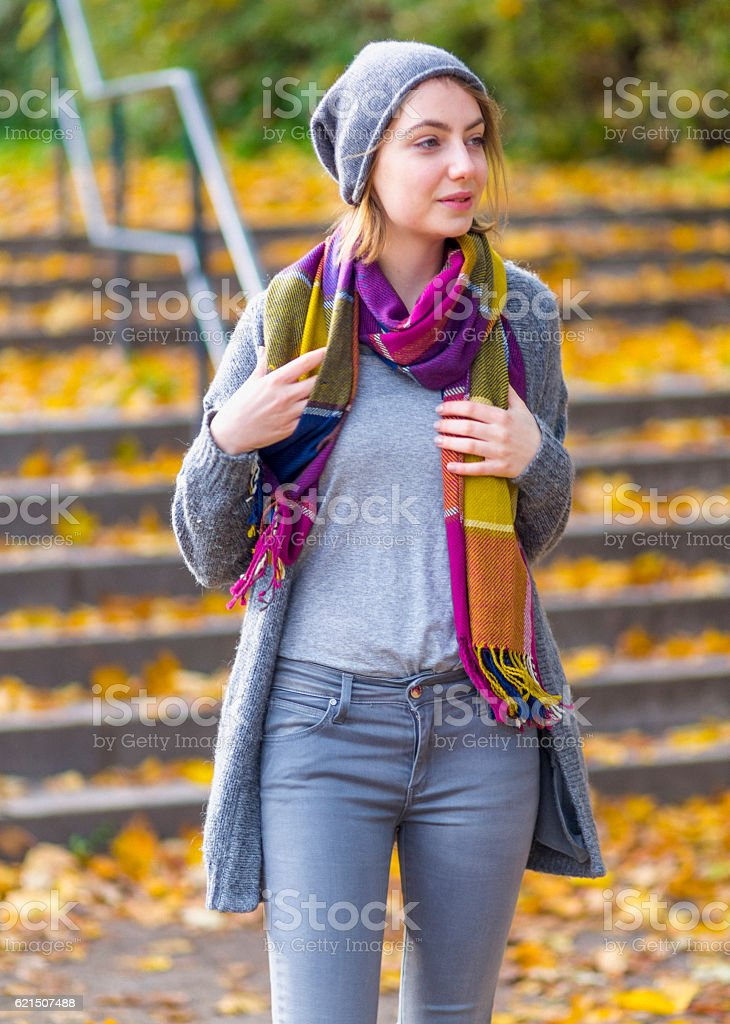 Woman walking at park in autumn photo libre de droits