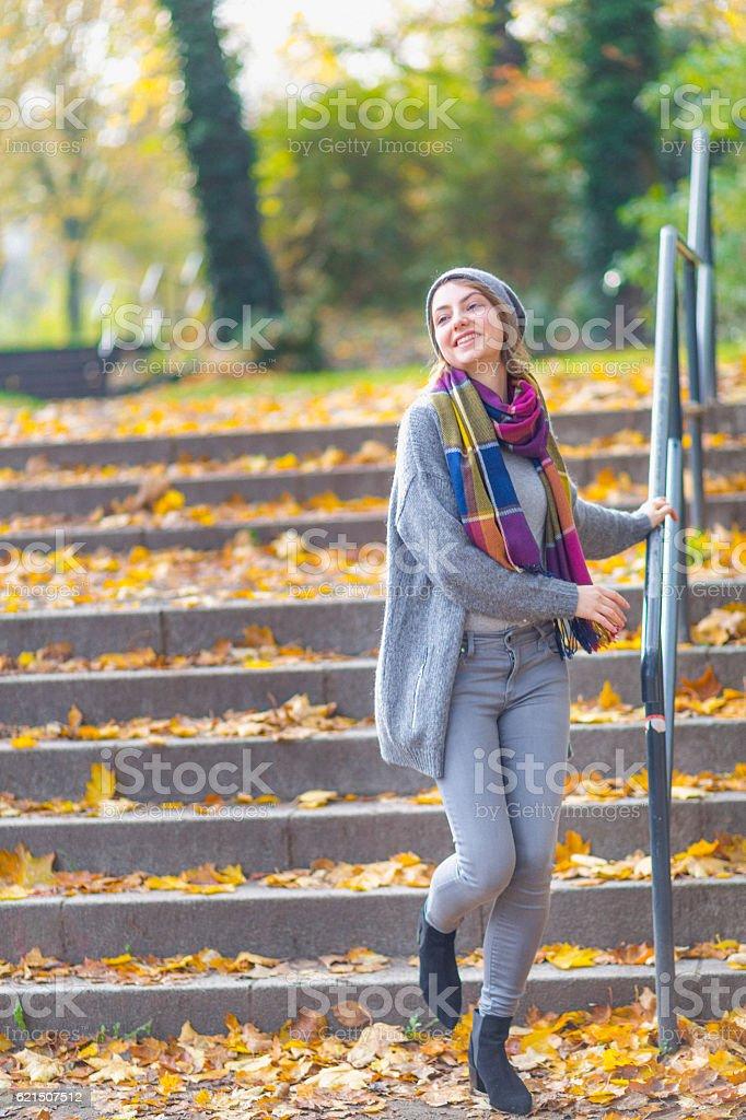 Woman walking at park in autumn photo libre de droits